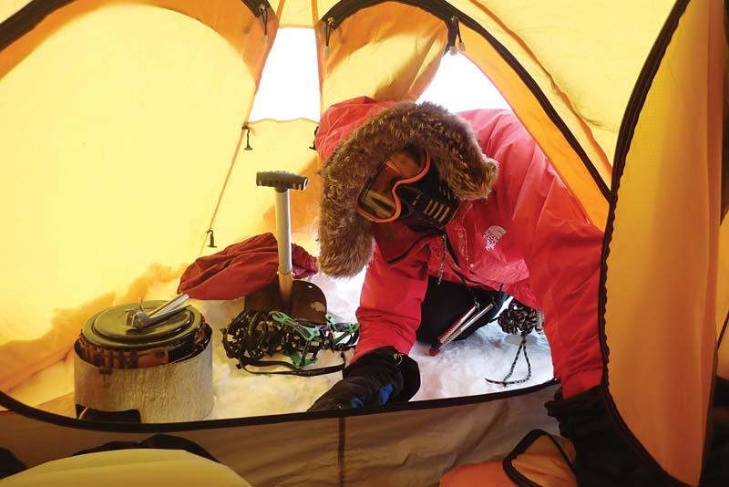 Greg Horne entering tent from blizzard